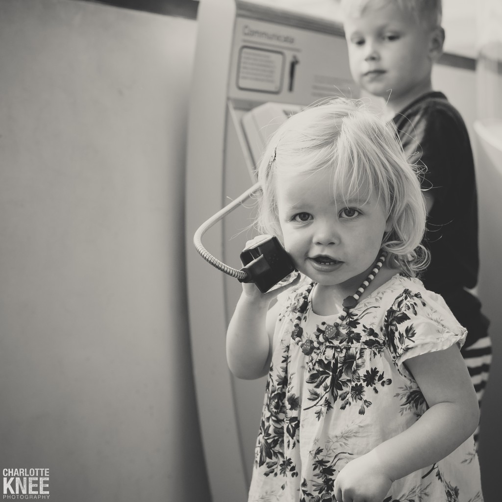 Maritime Museum Little Girl on Phone copyright Charlotte Knee Photography